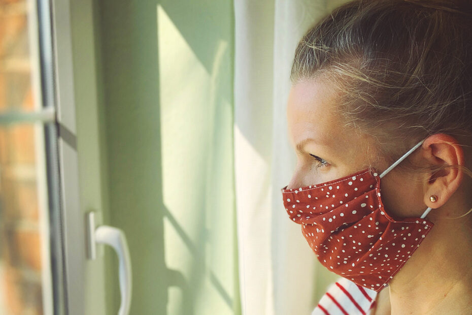 CDC image of woman wearing a mask to protect from the COVID-19 coronavirus.